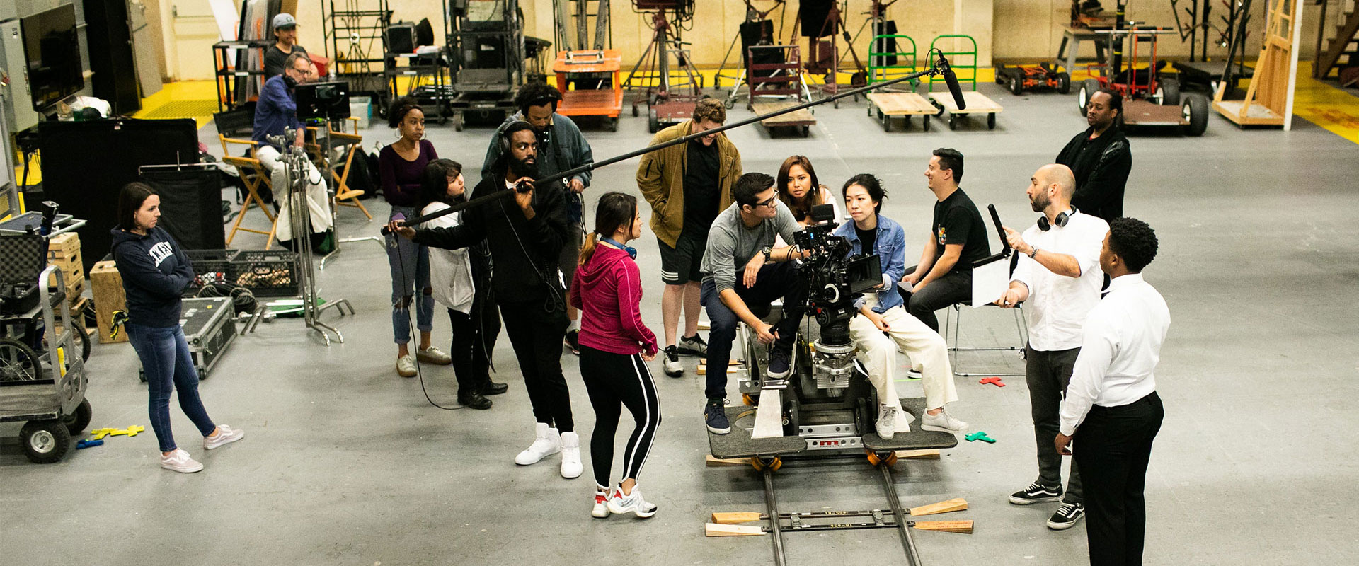 Students working on a scene where the camera is on a track